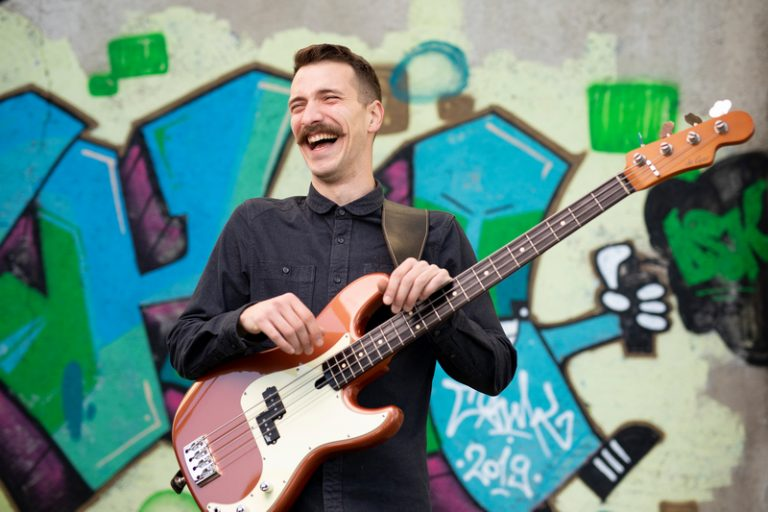 bass player laughing hard